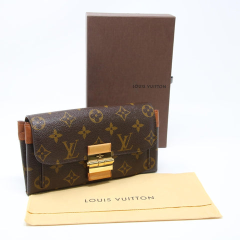 LOUIS VUITTON MONOGRAM SIGNATURE CANVAS ELYSEE PRESS LOCK