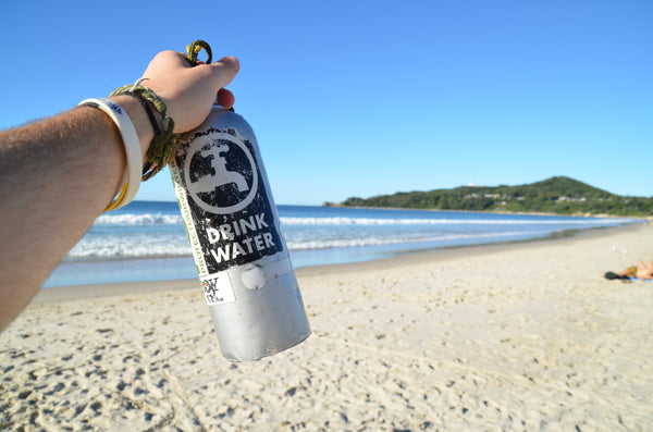 metal water bottle beach drink water