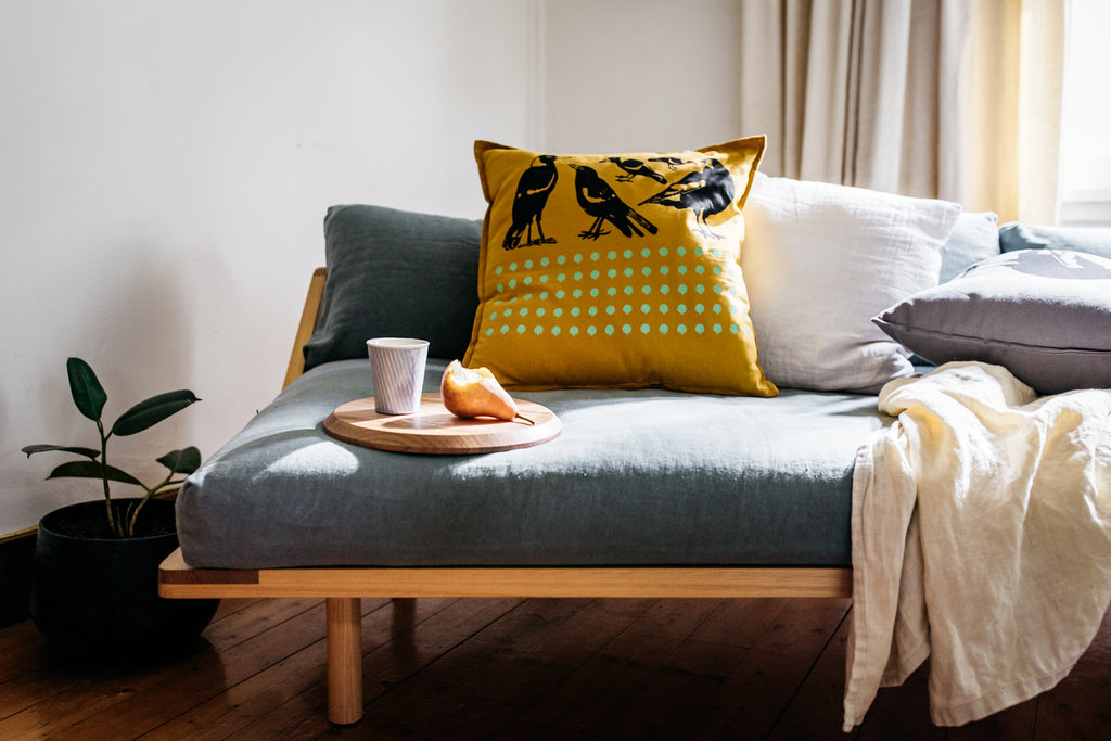 Images: Sofa with cushions, serving board and cup from Craft ACT.Photo: Lean Timms
