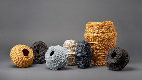 collection of textured ceramic vessels in blue, grey and gold
