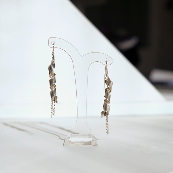 Silver twirling earrings