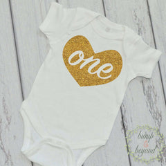 "Baby Girl First Birthday One Piece ""One"" Baby's First Birthday Shirt Gold Heart 1st Birthday Outfit Baby Girl Bodysuit READY TO SHIP 011 - Bump and Beyond Designs"