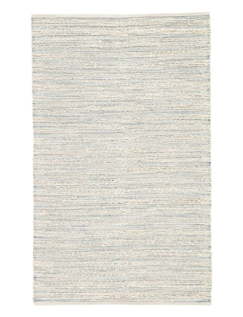 white washed jute rug with blue accent