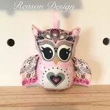 Pink tribal owl rattle