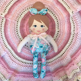 fabric doll and crochet rug