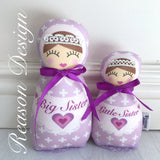 Purple babushka sister dolls