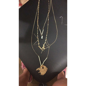 Three Tiered Gold Necklace With Stone And Tassel
