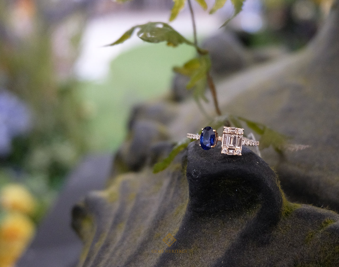 Blue sapphire and emerald cut illusion ring