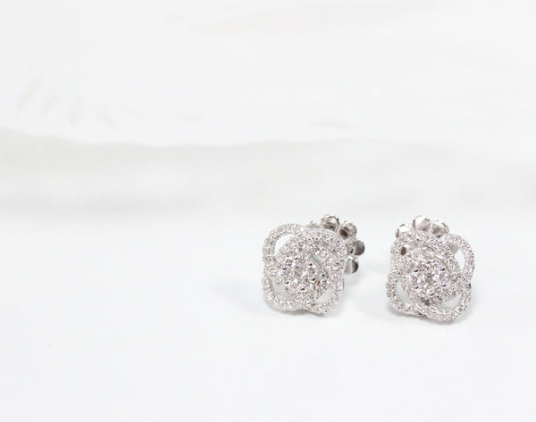 The delicate halo diamond earrings