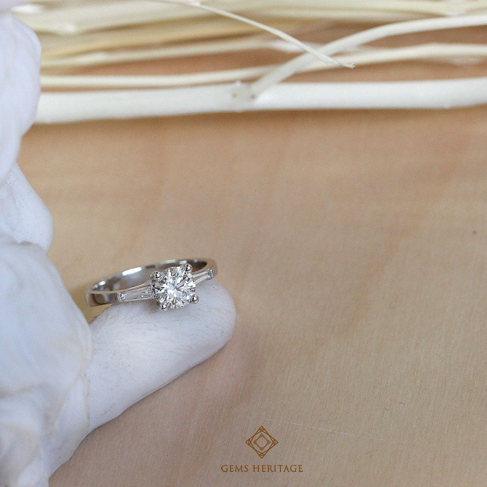 Engagement ring with taper diamonds ring