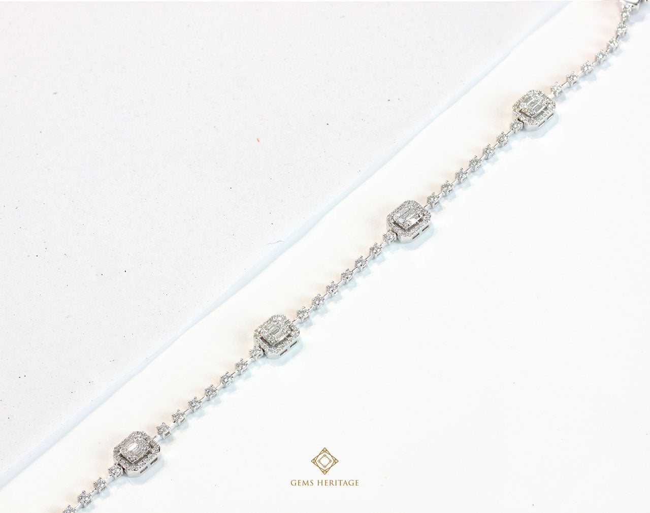 Emerald cut and dot diamond bracelet