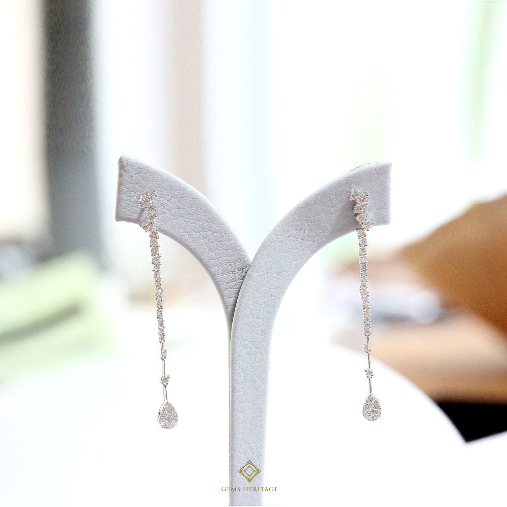Long pear diamond earrings
