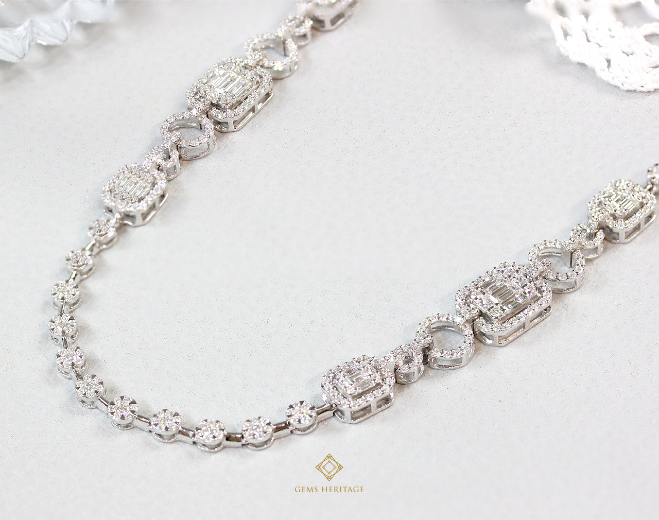 Emerald cut and circle diamond necklace