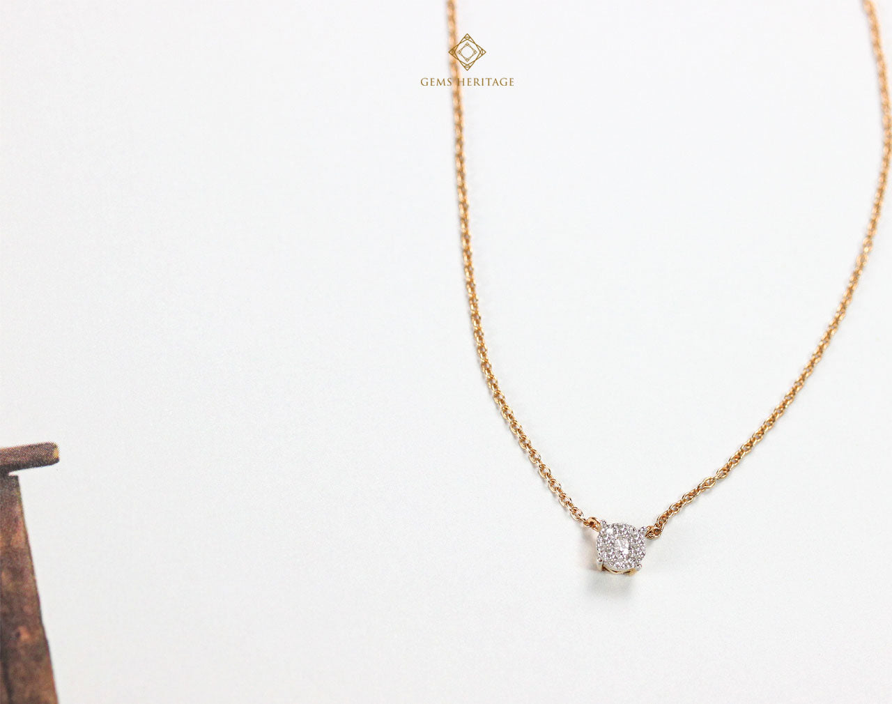 Minimal diamond pendant illusion setting