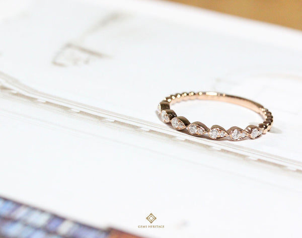 Mini pear diamond band ring