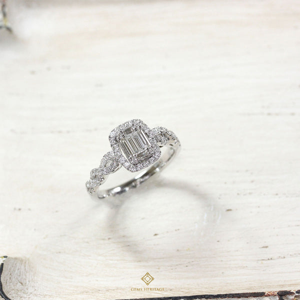 Emerald cut illusion diamond ring with curve side
