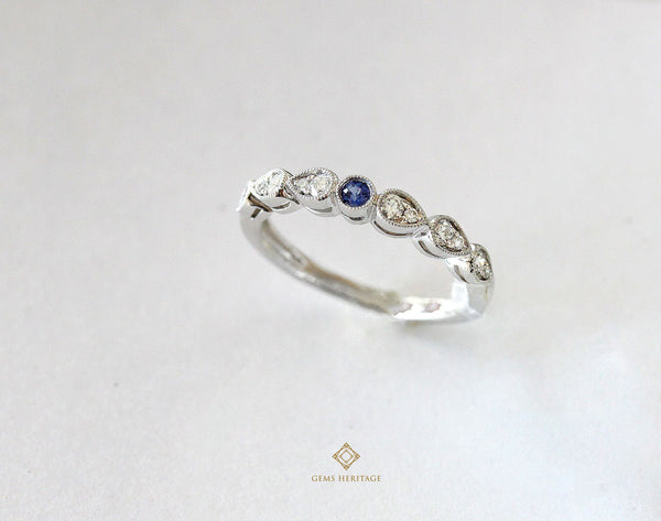 Tiny blue sapphire in a diamond ring