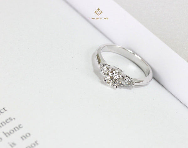 Engagement ring with pear shape diamond