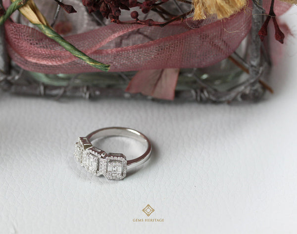 Three emerald cut illusion diamond ring