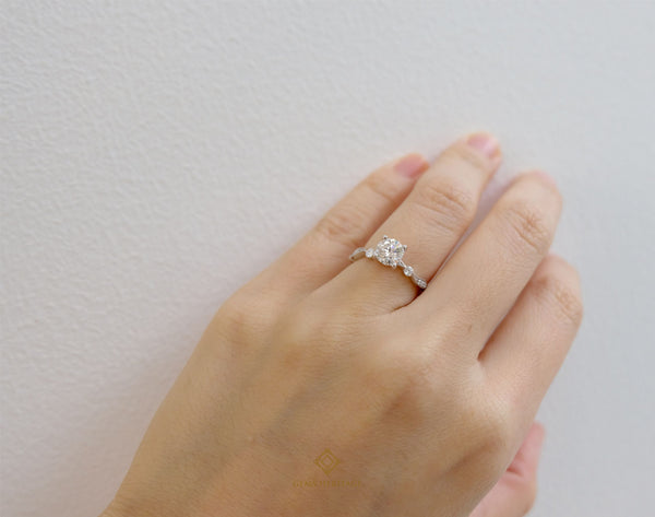 Dot and curve engagement ring