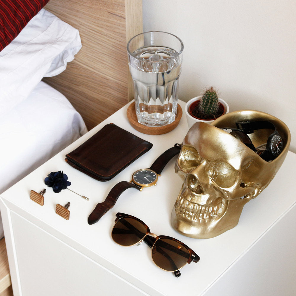 Skull Tidy by Suck UK A hollow skull for your essentials Measures 12.5cm(W) x 16cm(H) x 21.5cm(D) Highly detailed surface and shape the ideal place to store your wallet, keys, phone and belongings