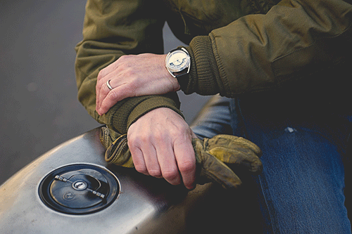 Motochrono watch on motorcyclists wrist
