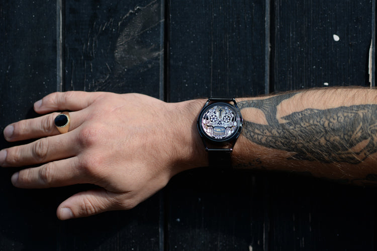Gilded skull tattoo watch on models wrist