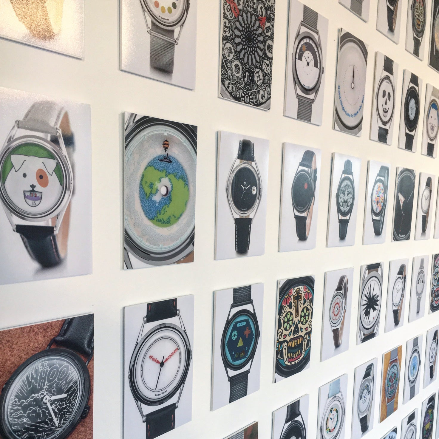 Display of watches covering the wall of the pop up shop