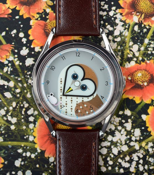 Timewise owl watch on floral background
