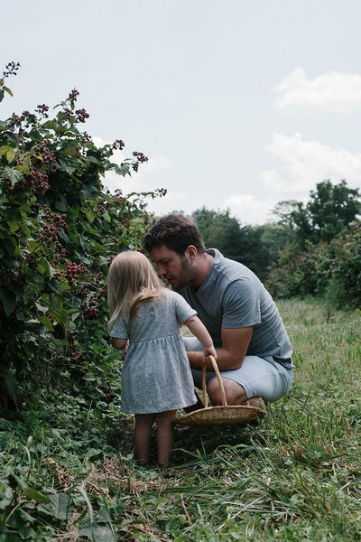 Daddy and daughter berry picking