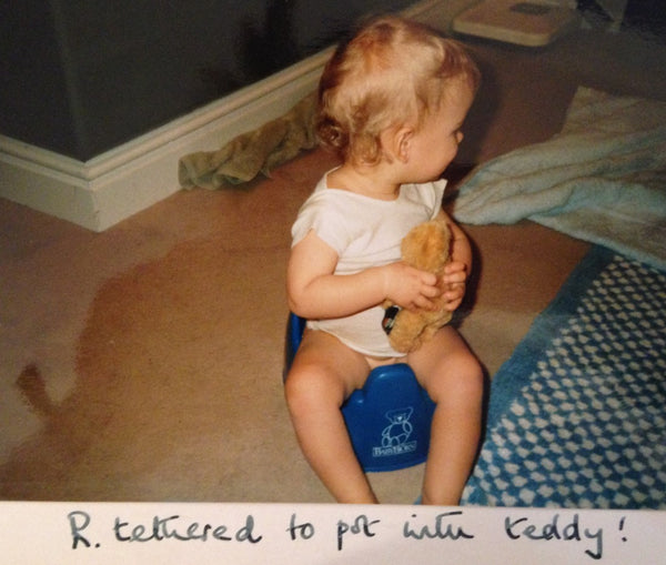Vintage childhood photograph, teddy bear, potty training