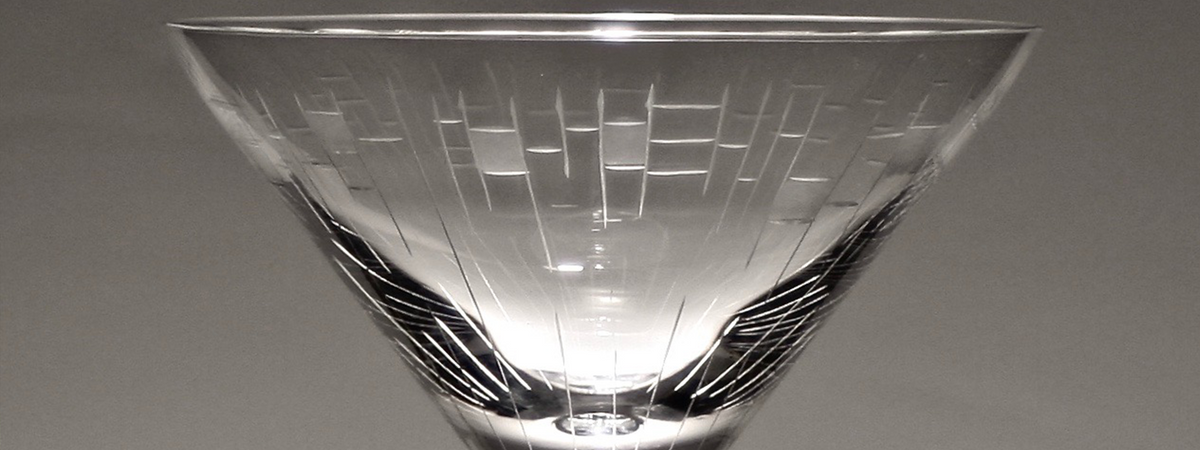 Crystal Matrix martini glass shot in black and white against gray, finely etched glass, mouth blown in Romania.