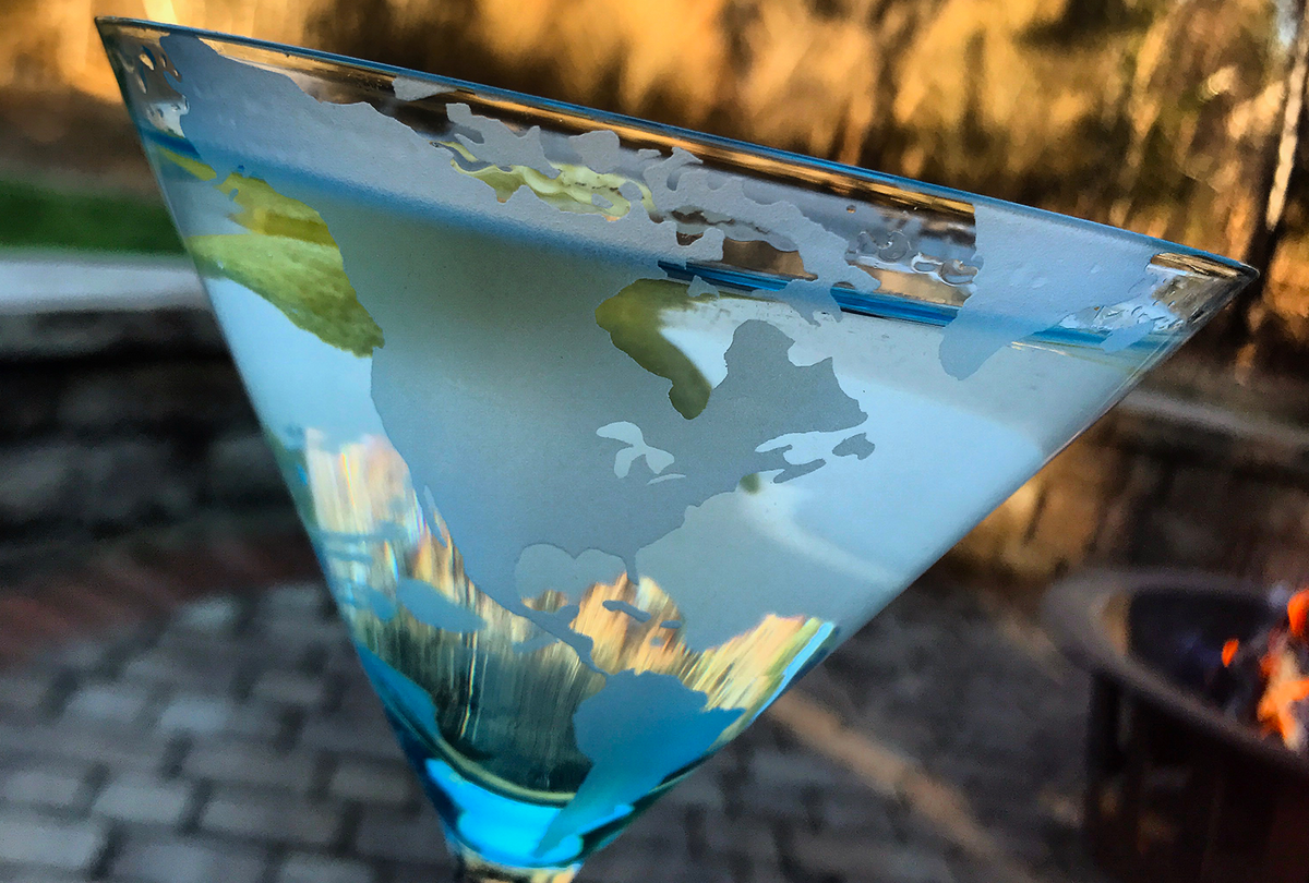 Earthly Concern martini glass from Tini Grails - map of the earth etched onto the bowl shot on a patio