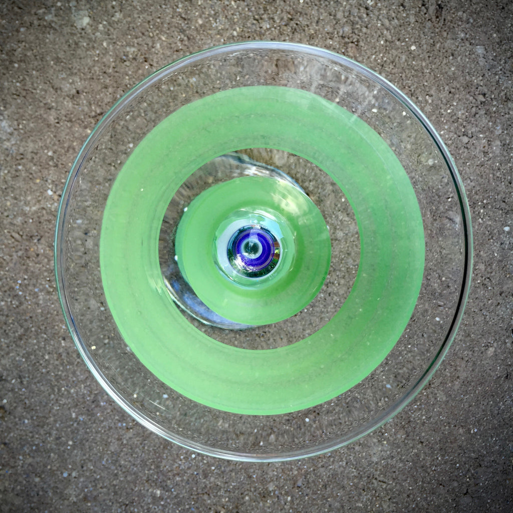 Floating Cuke martini glass at Tini Grails has hand-painted green stripes shot outside and from above.