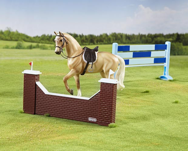 Great starter set for this popular equestrian event. Show jumping tests the partnership of the horse and rider, who must leap over a series of obstacles as cleanly as possible within an allotted time. Includes: horse, English saddle pad, English saddle & bridle, brick wall jump and plank jump. Ages 4+