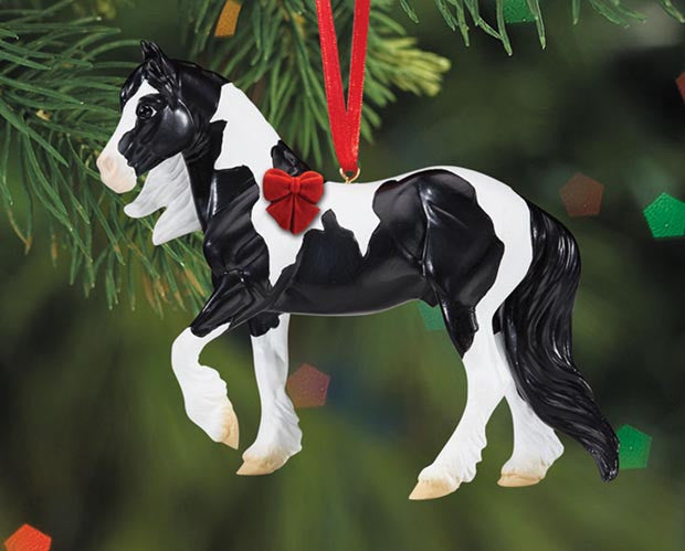 "Breyer's Beautiful Breeds ornament series celebrates the beauty and diversity of horse breeds fround around the world. The charming Gypsy Vanner breed is best known for their strength and kind temperament. Sculpted by Sommer Prosser, this handsome gelding showcases the breed's trademarks: a colorful coat , lush mane and tail, and feathered legs! 4""L x 4.4""H."