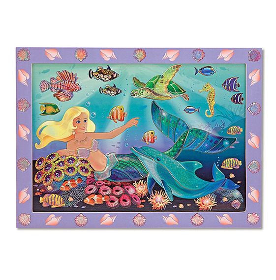 Give arts-and-crafts time some extra glitter with this cool kids' sticker-by-numbers activity. An enchanting underwater scene sparkles and shines when the stickers are pressed into place! Your little artist will love bringing this picture to life with shimmering sparkle-gem stickers. Includes extra stickers to give the wooden frame a finishing touch, too!