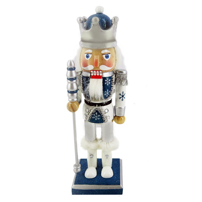 10 inch Nutcracker - Snow Fantasy with Crown  He's dressed in a winter motif, with a blue and white jacket decorated with hand-painted snowflakes; and a silver crown.  Holding a silver staff, with white boots and white fur cuffs on a blue base.