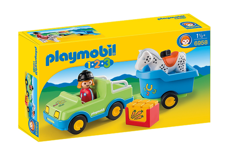 The Playmobil 1.2.3 Car with Horse Trailer is the ideal way to explore the equestrian world from a young age. The rider drives her horse to the upcoming tournament in the Car with Horse Trailer. If the horse gets hungry there is a box of carrots ready to satisfy its hunger.