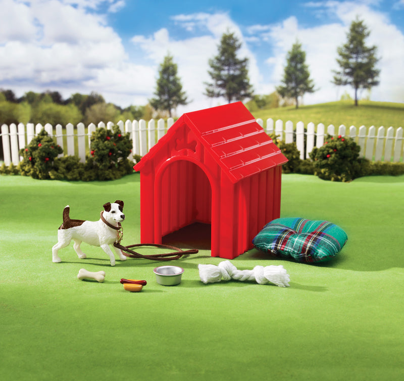 "What dog wouldn't be proud of this cute red dog house? Breyer's Dog House Set comes complete with an adorable Jack Russell Terrier and every comfort a dog needs: a soft comfy bed, leash and collar, water dish, rope pull toy, hotdog toy, and dog bone! Dog measures approximately 2.25""L x 2""H."