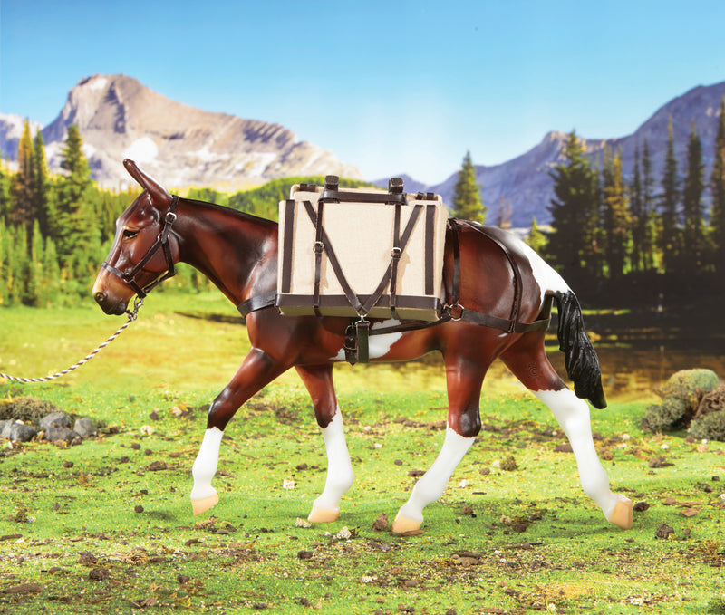 Head out on a wilderness adventure with the Pack Saddle with Panniers set. Realistically designed, it features a wooden saddle horn, cinching, saddle pad, halter, cotton lead with snap and two box panniers with straps and buckle closures.