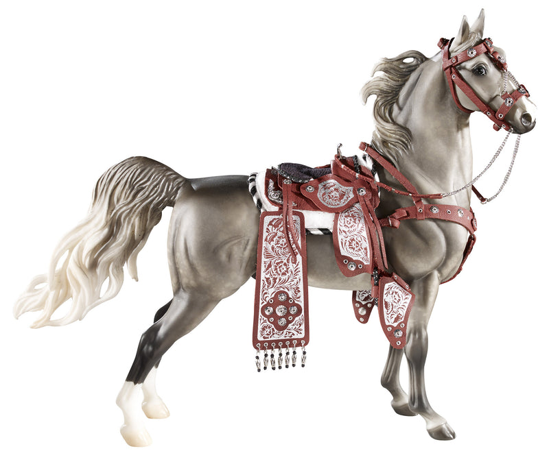 This beautiful set features a fancy Western parade saddle with tapadero stirrups, serape, breastcollar and bridle, all in a deep burgundy colour with silver-tone accents. Also includes parade saddle pad.
