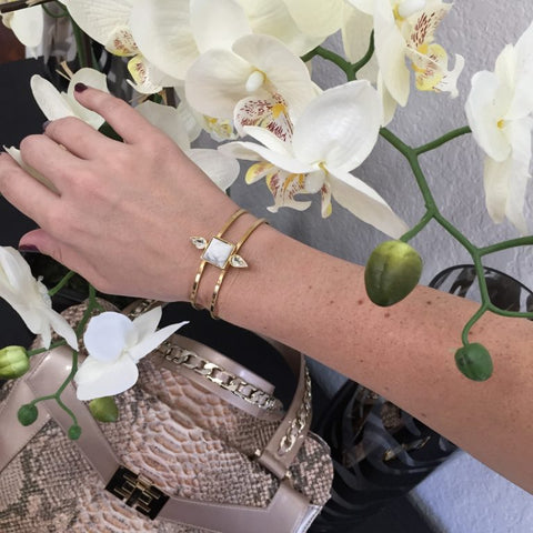 Haute In Texas' Aquila wearing our Iris Cuff in gold and howlite