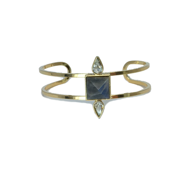 Gold fashion bracelet featuring two pear cut crystals and a natural iridescent labradorite stone in the center
