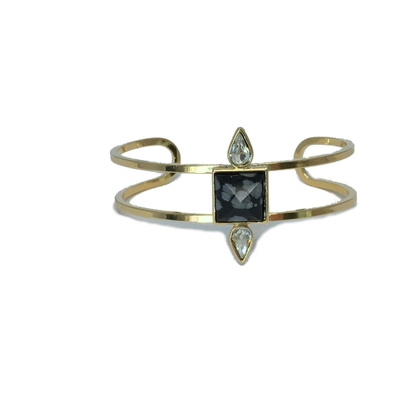 Gold fashion bracelet featuring two pear cut crystals and a natural grey and black obsidian stone in the center