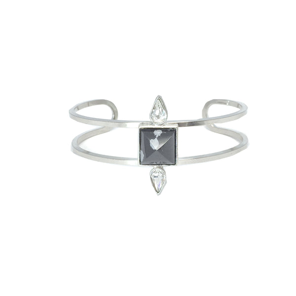 Silver fashion bracelet featuring two pear cut crystals and a natural black and grey obsidian stone in the center