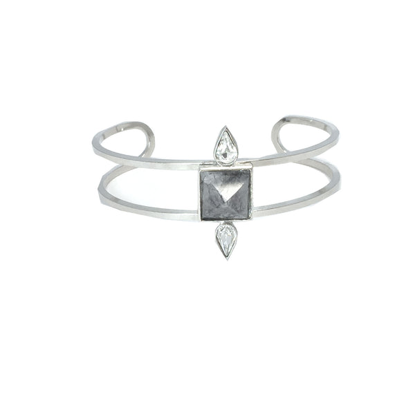 Silver fashion bracelet featuring two pear cut crystals and a natural clear and black rutilated quartz stone in the center