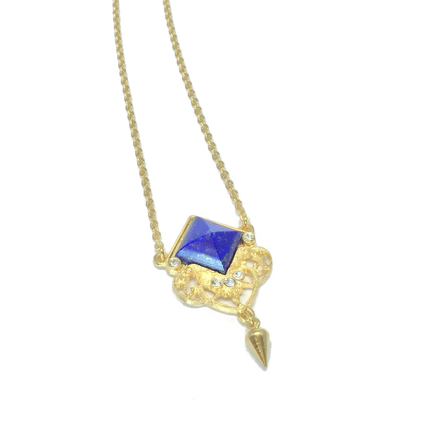 Delicate gold necklace with natural royal blue lapis stone and small teardrop charm
