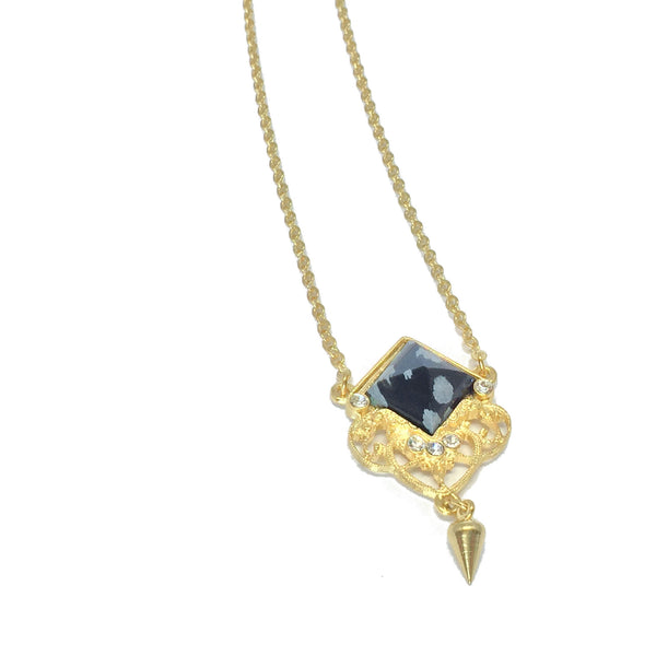 Delicate gold necklace with natural black and grey obsidian stone and small teardrop charm