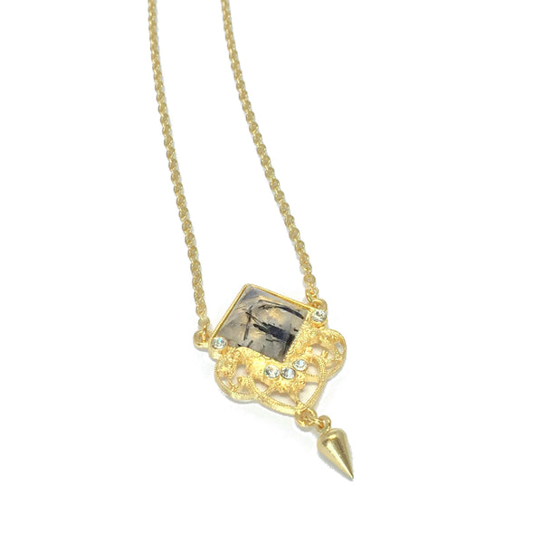 Delicate gold necklace with natural clear and black rutilated quartz stone and small teardrop charm